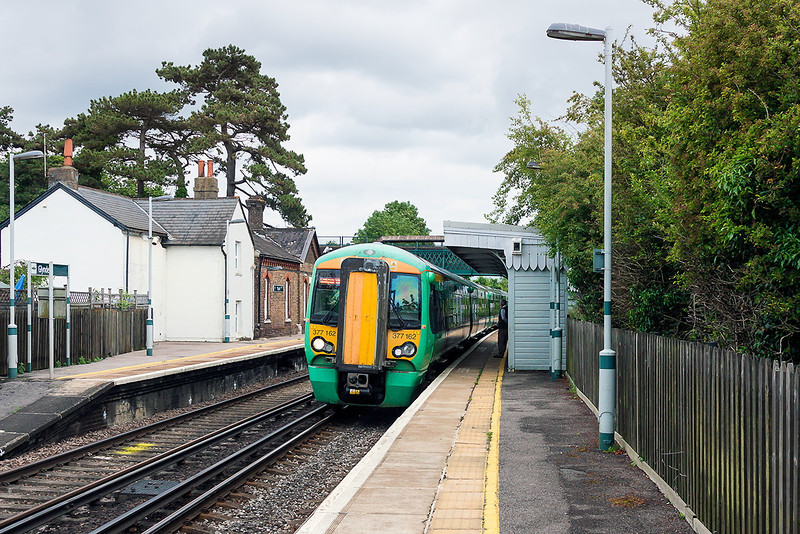 3rd Jul 13:  Rounding the curve through Glynde is 377162 on 1F37 the 13.50 from Ore to Victoria.