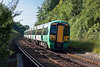 5th Jul 13:  Racing through Cooksbridge is 377109 working 1F09 the 07.20 Hastings to Victoria