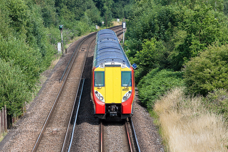 22nd Jul 13:  2C37 the 13.20 Waterloo to Reading  formed of 458014 & 458004 leaving Bracknell on a very hot afternoon