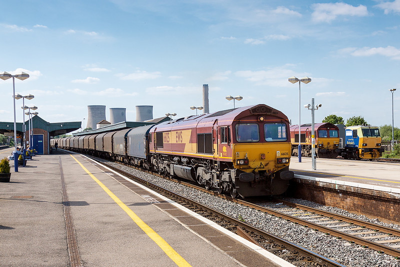 2nd Jun 13:  On a beautiful afternoon 66125 passes through Didcot at the helm of 6O31 covered steel carriers from Margam to Dollands Moor