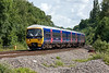 25th Jun 13:  As the driver gives the screen a wash as 165108 takes 2K44, the 10.12 Reading to Newbury, onto the West of England line at Southcote Junction