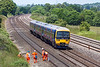 19th Jun 13:  165116 working 1P43 the 12.08 from Charlbury to Paddington passes workers surveying for the new OLE masts at Lower Basildon