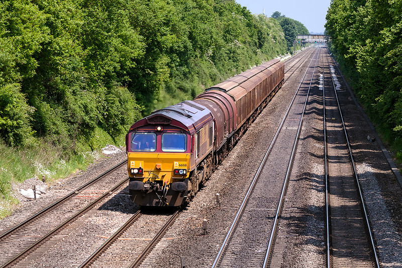 6th Jun 13:  66188 with a load of steel carriers and Cargo Wagons are forming 6V47 Tilbury IRFT to Trostre Steel Works at Milley Bridge