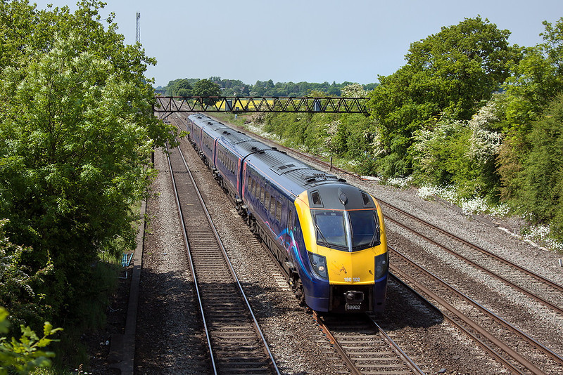 6th Jun 13:  1P40 is the 09.54 from Great Malvern to Paddington.  In the hands of 180102 it is seen here from Milley Bridge in Waltham St Lawrence