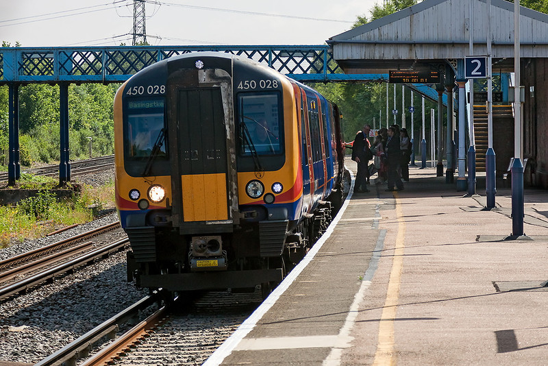 30th Jun 13:  South West Trains Desiro 450028 valls at Winchfield while working 2L21 the 09.07 Waterloo to Basingstoke