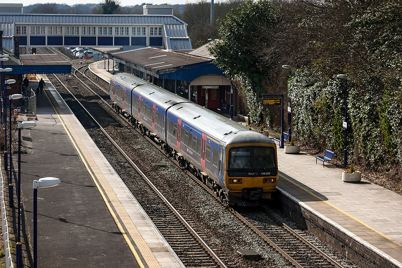 14th Mar 13:  The 13.07 from Oxford to Paddington in the hands of 166202 starts away from Twyford