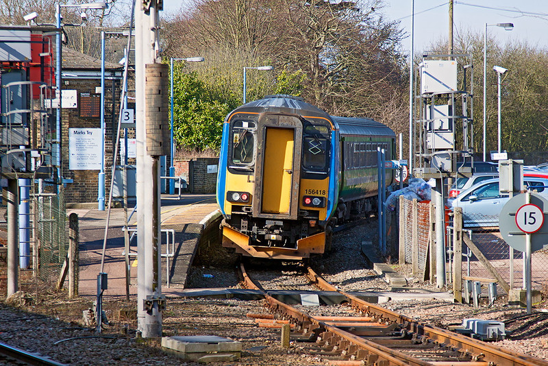 18th Mar 13:  The 10.01 to Sudbury formed of 156418 waits departure time at Marks Tey