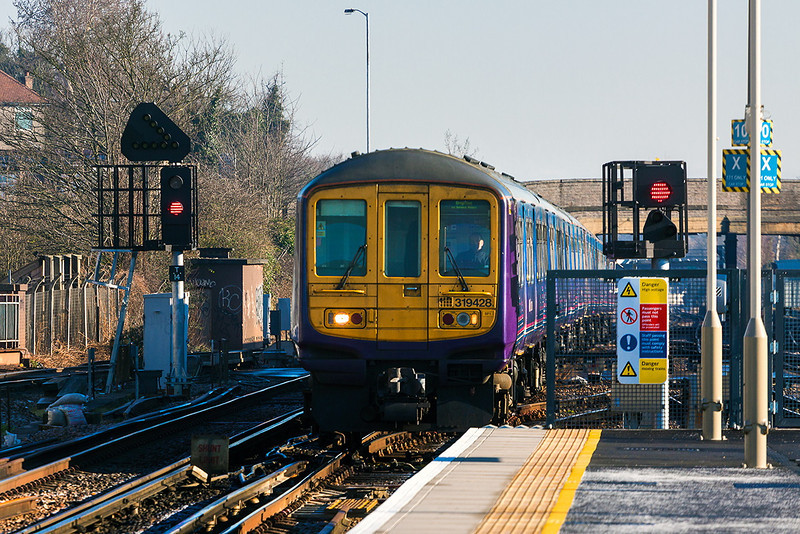 31st Mar 13:  319428 heads 2T17  the First Capitol Connect 08.41 service from London Bridge to Brighton through Norwood Junction.