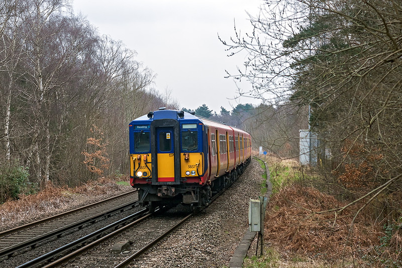 26th  Mar 13:  2C17 the 08.20 Waterloo to Reading is formed of a pair of 455s.  With 455857 leadiing they are captured at Longcross