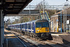 18th Mar 13:  The 09.18  from Liverpool Street to Clacton formed of 360107 races through Marks Tey
