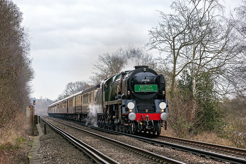 1st Mar 13:  The VSOE Surrey Hills Luncheon Special headed 35028 'Clan Line', as usual, is slowing for the Approach Controlled signal for the Chertsey line at Virginia Water