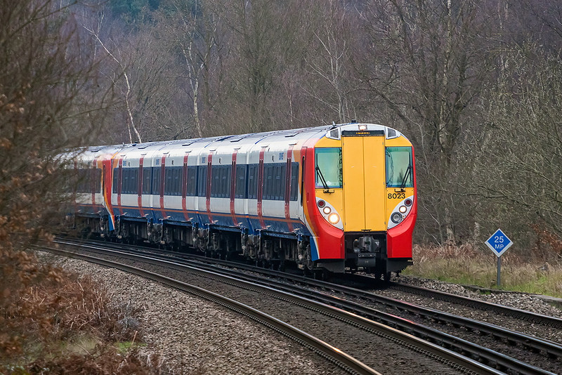 27th Mar 13:  458023 leads on the 13.50 Waterloo to Reading rounding the curve at Longcross.  70-200 F4L @ 188mm,  1/500 @ f4,  iso 800