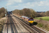 29th Mar 13:  66121+66061 catch some sunlight at Totters Lane,  between Winchfield and Fleet, as they head the morning Departmental from Eastleigh to Hoo Junction