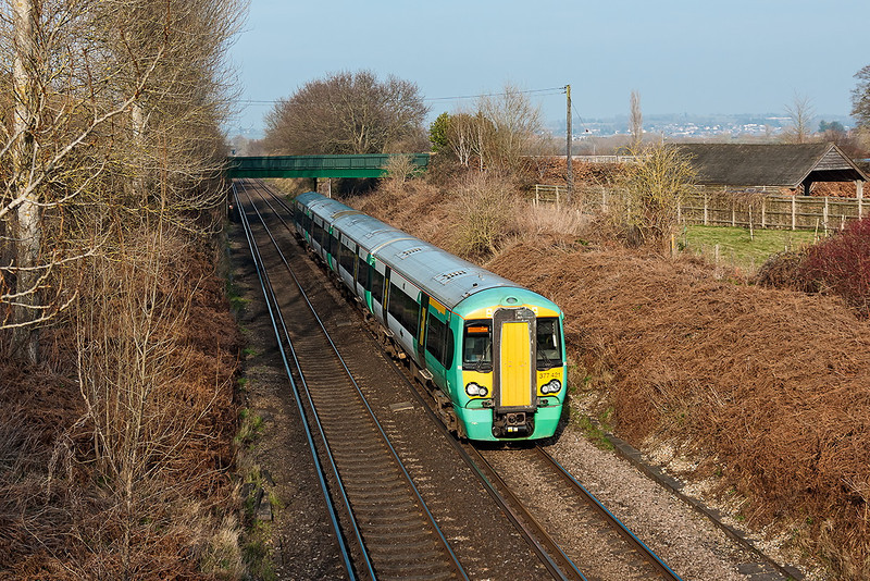 4th Mar 13:  Captured at Cold Waltham is 1C24 the 14.02 Victoria to Portsmouth Harbour formed of 377421