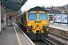 2nd Mar 13:  66523 standing in Platform 2 at Guildford.  Ii's load of the HOBC was standing in the tunnel mouth.  The loco was shut down