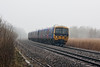 9th Mar 13:  On a very murky morning 166202 on 1K41 the 09.39 from Bedwyn to Paddington runs past tne Woolhampton Reed Beds