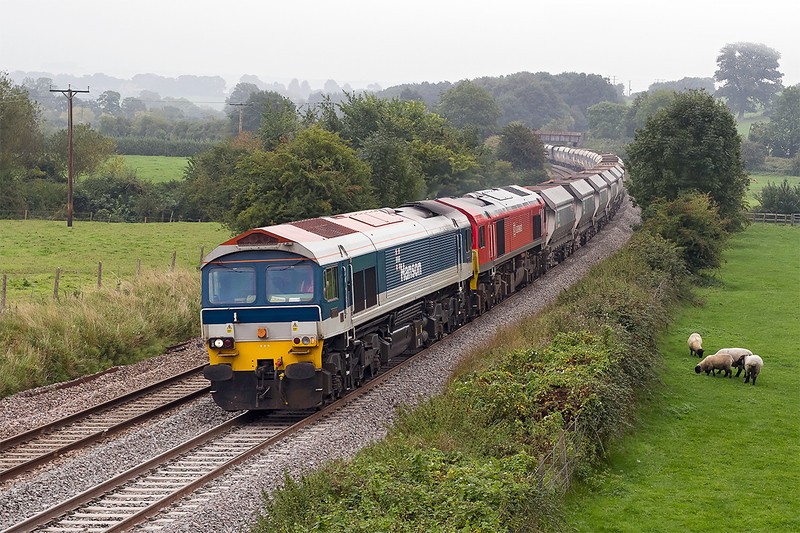 1st Oct 13:  On a very murky afternoon 59203 with 59204 DIT and 44 empties forming 6V18 from Hither Green to Whatley runs through Great Cheverell