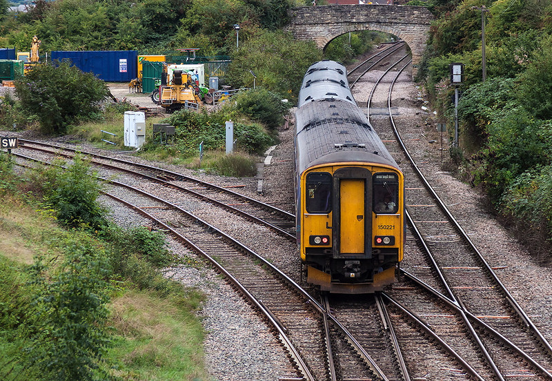 22nd Sep 13:  My first picture since my  return to live in my old home town of Westbury in Wiltshire.  With 158950 leading 150221 clatters over Hawkeridge Junction while working 1F23 the 14.53 from Bristol Parkway to Portsmouth Harbour