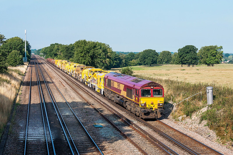 4th Sep 13:  66138 heads the morning Departmental service from Eastleigh to Hoo Junction slowly up the rise between Hook and Winchfield