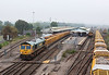 24th Sep 13:  On a misty morning 66621 runs through Platform 1 at Westbury with the 10.31 from Exeter Riverside to Stud Farm empty ballast boxes.  66623 was on the far end of the HOBC.