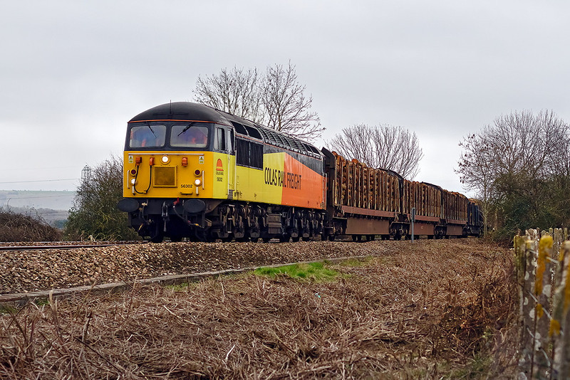 6th Feb 14:  Diverted via Westbury due to the continuing flooding near Bridgewater Colas Freight 56302 plods through Yarnbrook with the loaded logs from Heathfield to Chirk