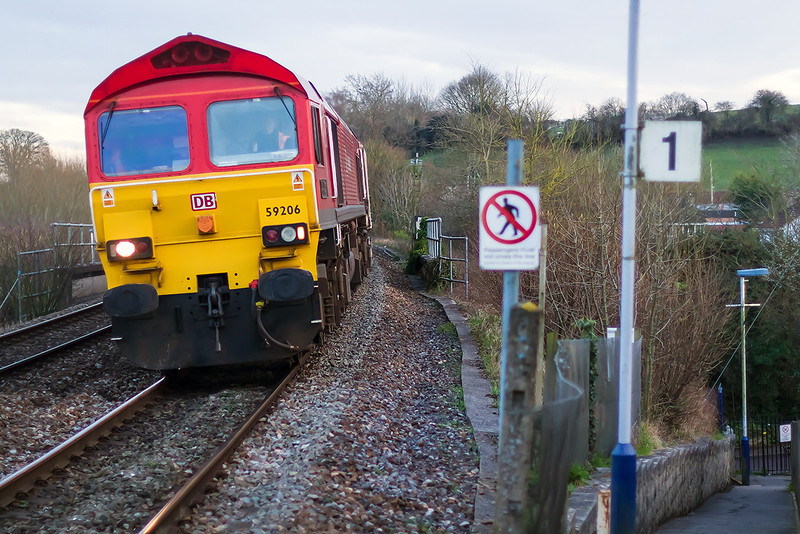7th Feb 14:  The returning empty stone boxes from Woking to Merehead {6V12) with 59206 on the point is captured at Dilton Marsh.  The Canon 50 mm f1.4 even at f1.8 has a very limited depth of field.
