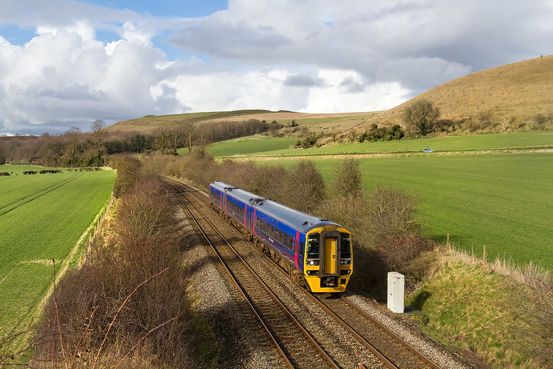 3rd Feb 14:  With a backdrop of Scratchbury Hill 158958  is nearing Heytesbury with 1F17 the 12.30 from Cardiff to PortsmouthHharbour