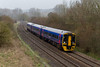 20th Mar 14:  Pictured at Sherrington in light drizzle is 159798 forming the 14.30 ,1F23, from Cardiff to Portsmouth Harbour