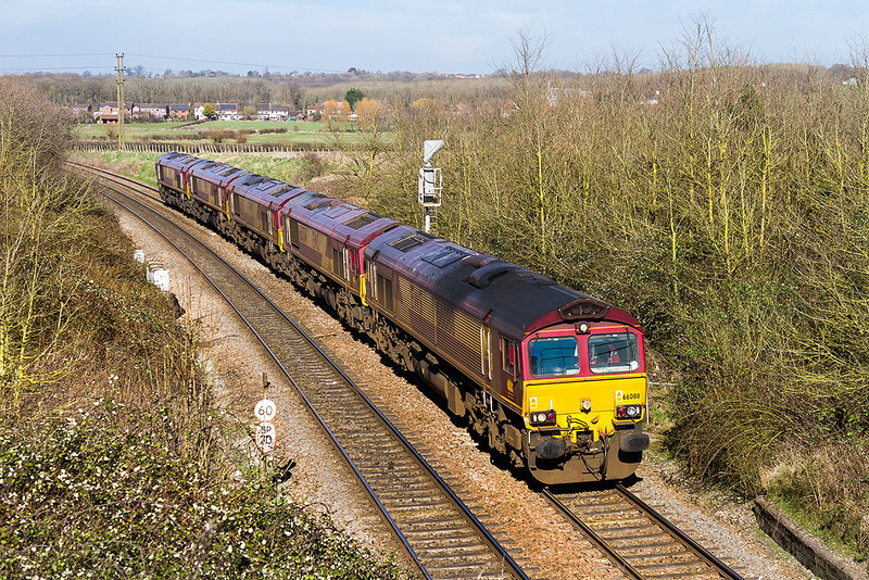 15th Mar 14:  The regular Saturday convoy from Margam to Eastleigh pictured at Hawkeridge Jumction.   The locos concerned are 66088+66054+66093+66098+66207.