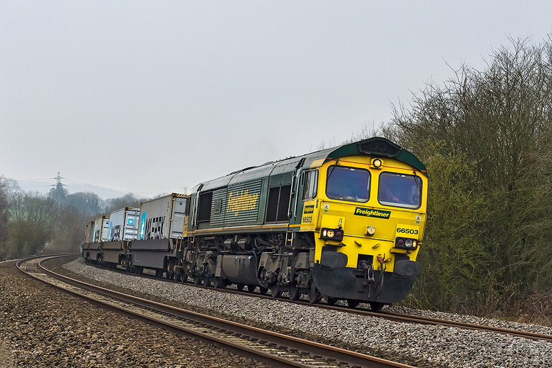 26th Mar 14:  On a misty & murky morning 66503 storms up the grade towards Box with 4L31 from Bristol FLT to Felixstowe