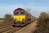 19th Mar 14:  Powering away from Fairwood Junction is 66158 working 6V18 empties from Hither Green to Whatley