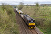 4th Apr 14:  Dropping down the bank at Upton Scudamore is WCR 33029 heading 6Z33 a crane move from Totton Yard to Westbury