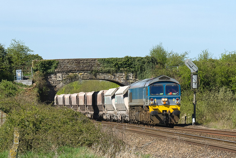 15th Apr 14:  Headed by the recently de-branded 59004 is 7A17 from Merehead to Acton. The classic view of trains leaving Westbury with the White Horse in the distance is taken form the bridge in the back ground.