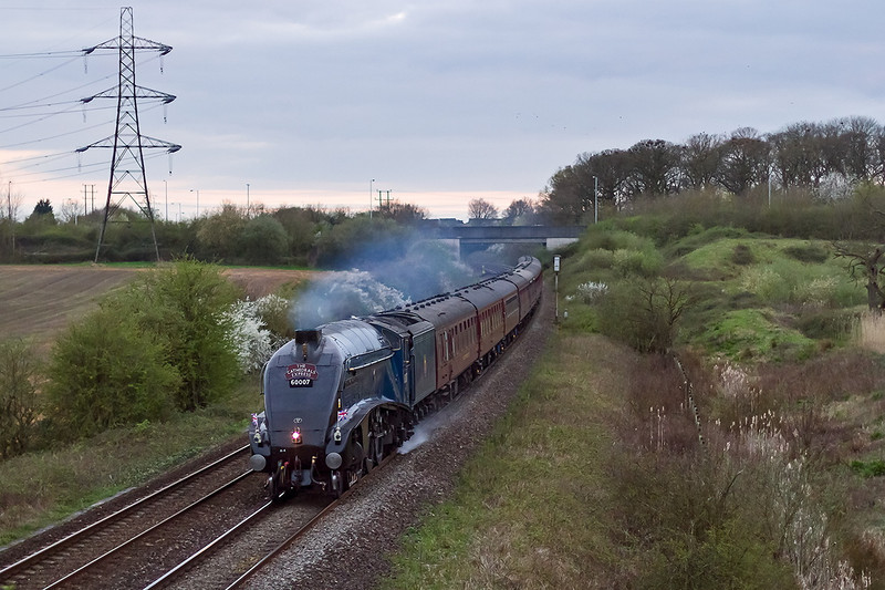 10th Apr 14:  Having journeyed to Kingswear 60007 'Sir Nigel Gresley' is  on time as it runs through Berkley Marsh with the Catedrals Express.  At Westbury the A4 will be removed and the train will continue to Woking behind a WCR Class 47.  Canon EOS 7D  1/1000 @ f1.8,  Canon 50mm f1.4 prime, iso 1600