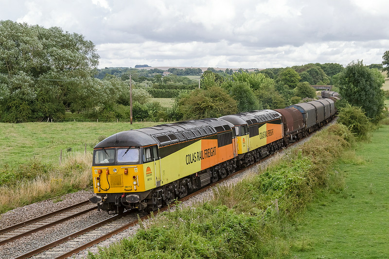 2nd Aug 14:  The a big black cloud overheadcalls for 800iso whem 56113 & 56089 pass with 6V72 from Tilbury tp Llanwern empty steel at Great Cheverell
