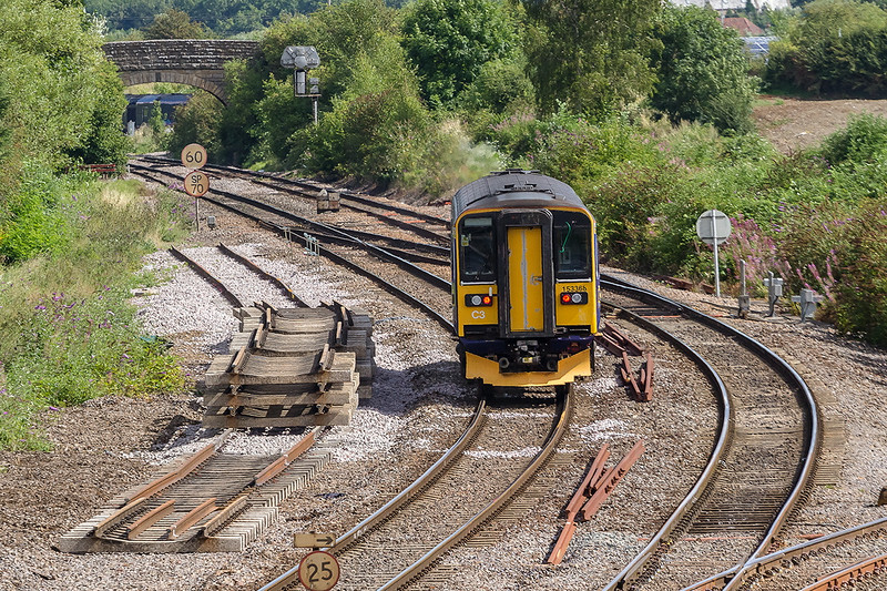 3rd Aug 14:  First Great Western 'Bug Box' 153368 forming 2F07 the 10.32 Westbury to Swindon is passing some new trackwork as heads towards Hawkeridge.  Just visible under the bridge is an HST  taking the East chord to gain the Berks & Hants line.  The HST is working 1L38  from Swansea to Paddington