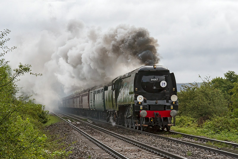 17th Aug 14:>  On a morning of intermittant rain 34067 'Tangmere' thrashes away from Fairwood Junction on the 'Weymouth Seaside Express'.  This is it's first tour since it was sidelined after the Connecting Rob parted company wit the Cross Head last year