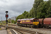 29th Aug 14:  66129 is in the proces of  compiling 6B50 the returning covered  steel empties from the Swindon Steel Store, just visible behind the trees, to Llanwern