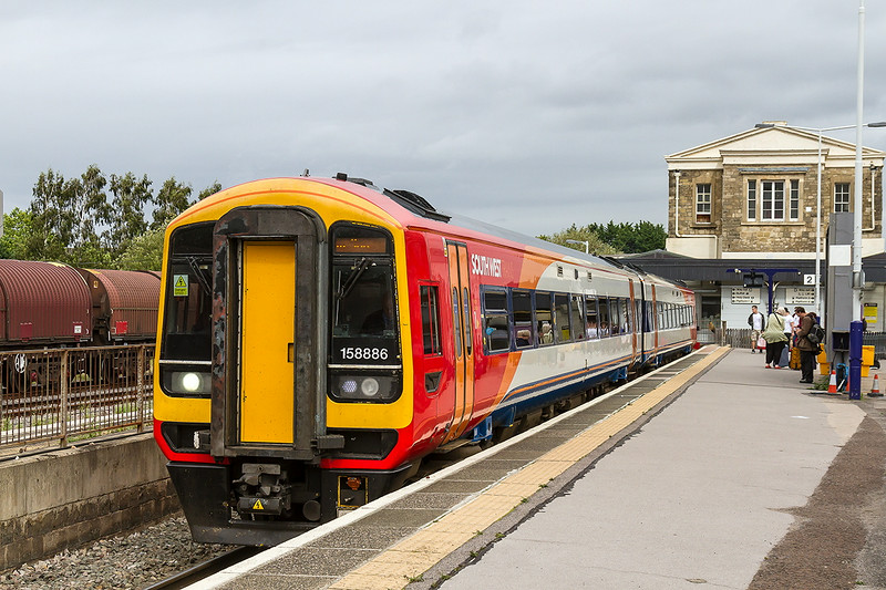 29th Aug 14: On hire to  FGW is SWT unit unit 158886 waiting in Paltform 2 with  2G35 the 13.38 Swindon to Cheltenham Spa service