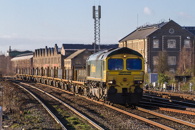 19th Dec 14:  Passing the old GWR Swindon Works is 66514 at the head of 4M18  itaking used conrete sleapers from Taunton Fairwater Yard to Washwood Heath