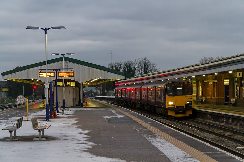 31st Dec 14:  At 07.59 on the last day of the year Westbury staion looks deserted though in fact there were a few  keeping warm in the waiting rooms. 150926 calls with 1F03 the 06.28 Cardiff to Portsmouth Harbour.