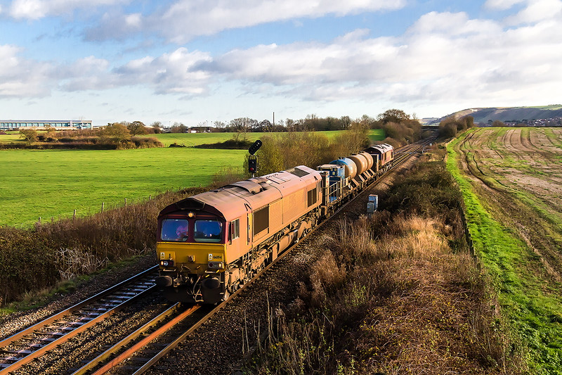 8th Dec 14:  On what will probably be the last week of the RHTT season 66194 with 66183 on the rear are pictured at Fairwood on their way back to Parr