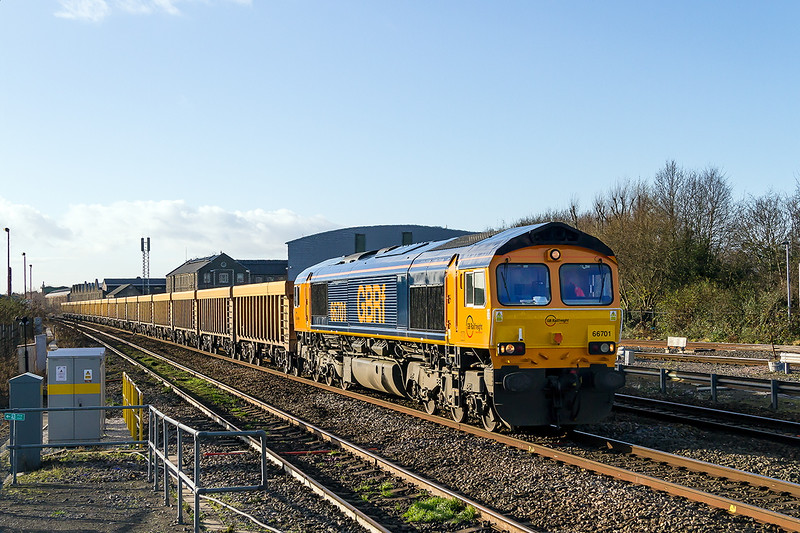 19th Dec 14:  Recently repainted into the originlal GBRf  livery  but sporting GB Europorte insignia the pioneer loco 66701 hurries through Swindon with 6M40 from Westbury to Stud Farm