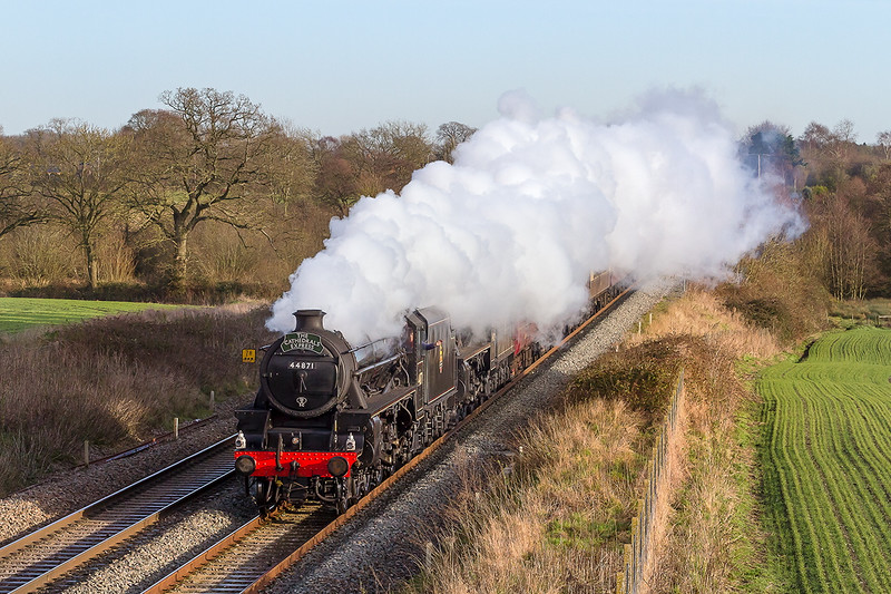 16th Dec 14:  With a friendly wave from the driver LMS Black 5s 44871 and 45704 head the Cathedrals Express though Woodborough.  Starting from Newington in North Kent 1Z31 is going to Bath.  On what seemed to be a dead still day the steam carefully obliterated the view of the train