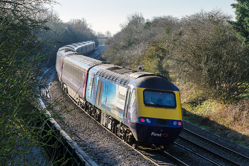 29th Dec 14:  Bringing up the rear of 1C79 the 10.30 from Paddington to Plymouth is 43163 with 'Visit Plymout'h brarnding.  Due to engineering work the B & H is closed  so the service is diverted via Swindon and Melksham.   Captured here on the rise between Bradford Junction and Trowbridge.