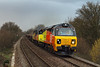 25th Feb 14:  70801 with 56302 in the consist grinds uo the fill thoiugh Dilton March with 6Z30 the 17.18 Departmental from Westbury to Eastleigh.  800 iso again as the light had just caved in.