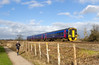 21st Feb 14:  158952 passing a runner on the path behind the White Horse Business Park when working the 11.30 from Cardiff to Porrtsmouth Harbour