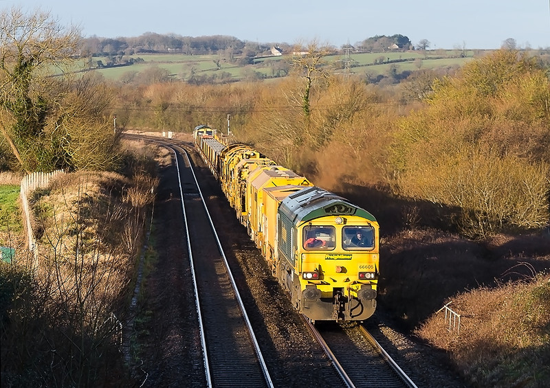 13th Jan 14:  66605 leads on a somewhat shorter than expected Track Relaying Train with 66619 bringing up the rear.  The train, captured just East of Fairwood Junction and on the Westbury Cut Off, is working to Eastleigh from Taunton Fairwater Yard