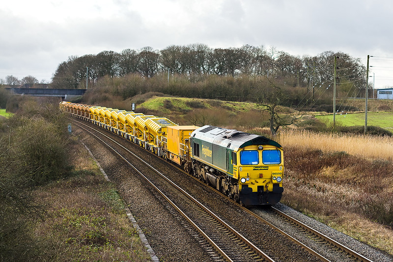9th Jan 14:  66550 cruises through Berkly Marsh with 7C84 bringing  hoppers from the HOBC for a top up at Westbury Virtual Quarry