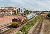 2nd Jul 14:  Running nearly 5 hours late is 4O20 loaded Jaguar cars from Castle bromwich to  Southampton Eastern Docks.  66095 is pictued from the Campbell Road bridge where the Buddleia is fast becoming a problem
